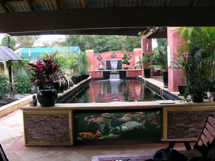 Attaching glass to a fiberglass pond for Koi pond glass
